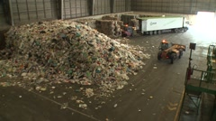 Loeders working in warehouse of recycling industry Stock Footage