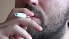 Close up young man with cigarette smoking, exhaling smoke on nose nostrils 4K Stock Footage