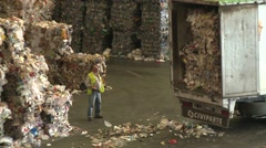 Waste for recycling purposes being loaded into lorry Stock Footage