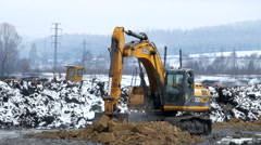 Excavator digs the ground Stock Footage