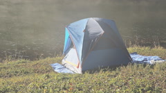 Waterfront tent and Fog on the water in morning at Pang-ung, Pine forest in Mae - stock footage