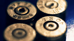 Spent cartridges with a broken capsule and moving light. Closeup - stock footage