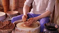 Potter making a clay vase Stock Footage