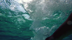 Underwater shot of hitting water surface with a hand and making bubbles Stock Footage