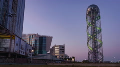 Stock Video Footage of Sunset timelapse of Alphabet Tower in Batumi, pan zoom
