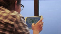 Woman using tablet pad for browsing map during travel trip on ferry board Stock Footage