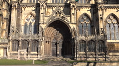 Lincoln Cathedral England woman walks past ancient door 4K Stock Footage