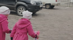 Walking two small girls-sister Stock Footage