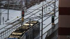 Tram passing through traffic light, Stockholm, Sweden Stock Footage