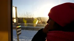 Pensive young woman riding the tram in sunflare sunlight, steadicam shot Arkistovideo
