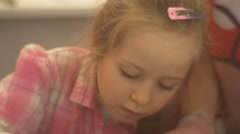 Blonde Little Girl Decorating a Cat Shaped Candy Attentively Learning to Make Stock Footage