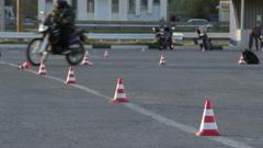 Motorcycle practice in traffic between cones Moto Gymkhana Motorcyclists - stock footage