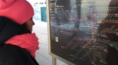 Girl tourist looking the metro map and deciding where to go Stock Footage