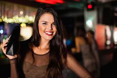 Smiling woman standing in bar Stock Photos