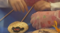Kid Are Decorating a Yellow Candy on a Stick Learning to Make Sweets Excursion Stock Footage