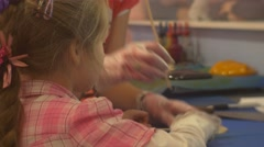 Kids Are Learning to Make Sweets Decorating Caramel on a Stick Confectioner is Stock Footage
