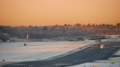 Jet plane departs from airport runway sunset, sunrise 4K UltraHD Stock Footage