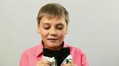 Caucasian Teen Boy Child eating a chocolate bar Stock Footage