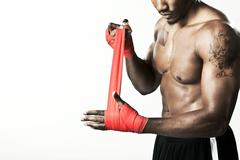 Boxer wrapping hand with bandage Stock Photos