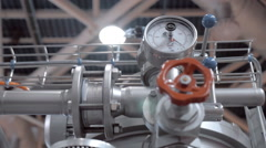 Modern complex technological industrial equipment. A red tap (faucet) - stock footage
