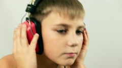 Teen Boy child music lover fan listens music in headphones, audio player  - stock footage