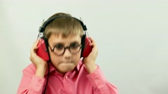 Teen Boy child music lover fan listens music in headphones with glasses Stock Footage