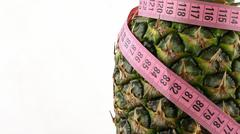 Pineapple and Measurement Fit Life Concept - stock photo