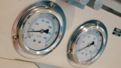 Acutely movement the arrows of pressure gauge, liquid filled for more accurate - stock footage