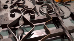 Rough metal curly decorative elements on the table Stock Footage