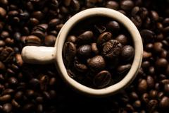 Coffe beans and cup. Stock Photos