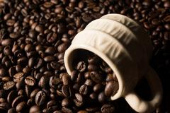 Coffe beans and cup. - stock photo
