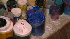 Jar of Blue Paint Next to Other Colors - stock footage
