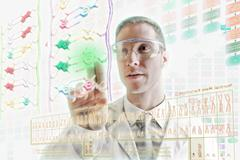 Scientist interacting with holographic screens Stock Photos