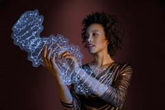 Woman interacting with holographic genome Stock Photos