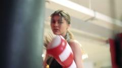 Beautiful brunette boxing pear. 4k - stock footage
