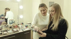 Artist show pictures of makeup on the digital tab Stock Footage