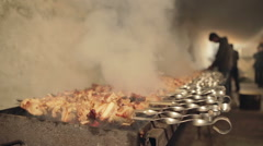 Close Up of Meat Skewers Cooking Over Hot Coals on Outdoor Smoking Barbecue Stock Footage