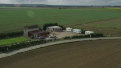 Stock Video Footage of Aerial of farmhouse amidst the beautiful field
