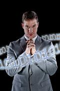 Businessman surrounded by ring of binary code Kuvituskuvat