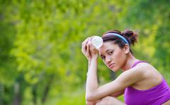 Young woman holding water bottle Stock Photos