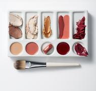 Artists palette with make up and brush Stock Photos