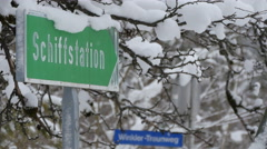 Ship station sign covered with snow in Hallstatt Stock Footage