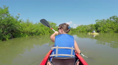Woman and tour guide kayaking on big calm river canal Stock Footage