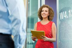 Young businesswoman holding file in office Stock Photos