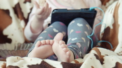 Legs, feet of the little girl sitting in a chair Stock Footage