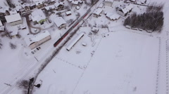 Aerial view of a train riding in Hallstatt during winter - stock footage