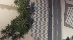 Flying above Copacabana Beach iconic sidewalk Stock Footage