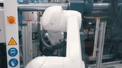 Movement molds, robot arm manipulator takes the finished product and stock them - stock footage
