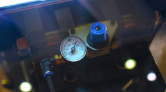 Gauge indicate surges of pressure in the system of industrial equipment Stock Footage