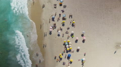 Overhead shot of people relaxing on the beach Stock Footage